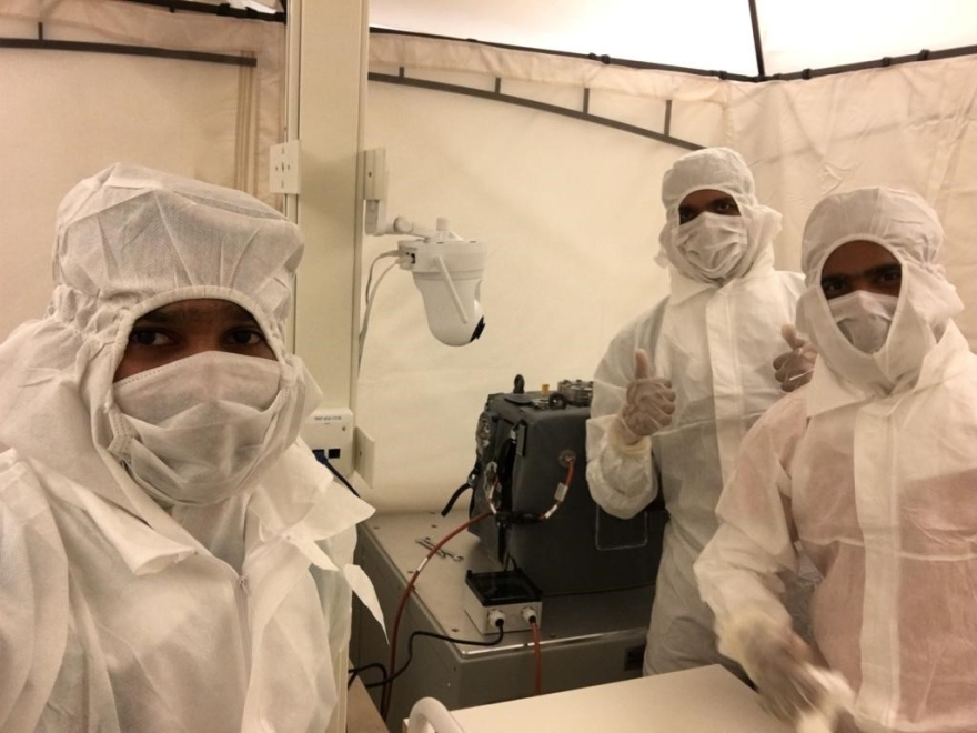 GAS PhD students wearing cleanroom garments