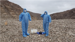 Team scientists in sterile garment during one of the sampling campaigns
